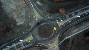 Cars are moving through a newly built traffic circle stock video