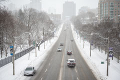 Cars on slushy road Stock Image
