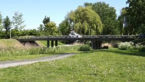 Cars on a small bridge. Cars going over a small bridge in Almere, The Netherlands stock video