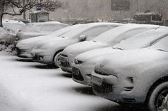 Cars snow. Cars are under snow during a snowfall Royalty Free Stock Photo