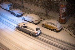 Cars in snow Stock Images