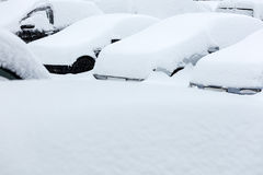 Cars in snow during blizzard. Cars covered with snow in the parking lot during winter blizzard Stock Photography