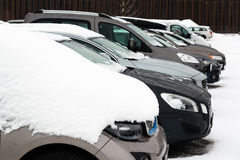 Cars with snow on a parking lot Royalty Free Stock Image