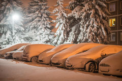 Cars in snow after snowstorm in night, winter photography and snow calamity Royalty Free Stock Photo