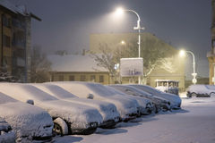 Cars in snow after snowstorm in night, winter photography and snow calamity Royalty Free Stock Photos