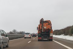 Cars and special purpose vehicle for wet waste disposal on an autobahn, Germany.  Stock Photo