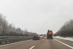 Cars and special purpose vehicle for wet waste disposal on an autobahn, Germany.  royalty free stock photo