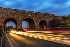 Cars speed line and the ancient city wall Royalty Free Stock Photo