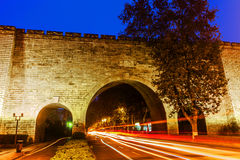 Cars speed line and the ancient city wall Royalty Free Stock Image