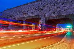 Cars speed line and the ancient city wall. This is the ancient Chinese in Nanjing city wall and the car's speed line Royalty Free Stock Photography