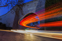 Cars speed line and the ancient city wall. This is the ancient Chinese in Nanjing city wall and the car's speed line Royalty Free Stock Photos