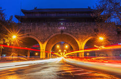 Cars speed line and the ancient city wall. This is the ancient Chinese in Nanjing city wall and the car's speed line Stock Photos