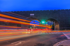 Cars speed line and the ancient city wall Stock Image