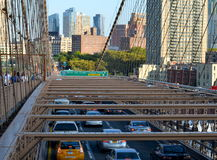 Cars speeding on the Brooklyn Bridge from Manhattan to Brooklyn. Stock Images