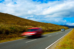 Cars Speeding on Country Road. Two Cars Speeding on Country Road Royalty Free Stock Photo