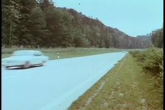 Cars speeding down country road stock video footage