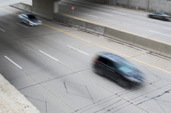 Cars Speeding Down The Highway of Life. Blurred cars racing down a freeway in Detroit Royalty Free Stock Photo