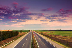 Cars speeding on a highway Stock Photo