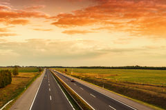 Cars speeding on a highway Royalty Free Stock Photo