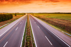 Cars speeding on a highway Stock Photography