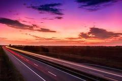 Cars speeding on a highway Stock Image