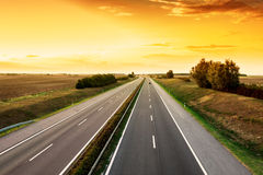 Cars speeding on a highway Royalty Free Stock Images