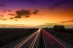 Cars speeding on a highway Stock Photos