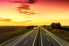 Cars speeding on a highway Stock Images
