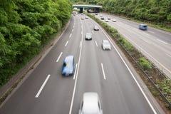 Cars speeding Stock Photos