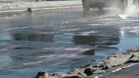 Cars splashing water Stock Images