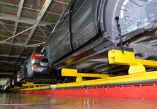 Cars stand on the conveyor line of assembly shop. Automobile pla Stock Photography