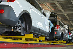 Cars stand on the conveyor line of assembly shop. Automobile pro. Duction Royalty Free Stock Photos