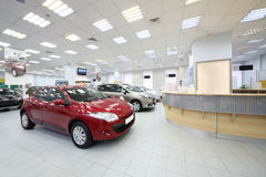 Cars stand near racks for customers. MOSCOW - AUGUST 28: Cars stand near racks for customers in dealership Avtomir on Baykalskaya, on August 28, 2012 in Moscow Royalty Free Stock Photos
