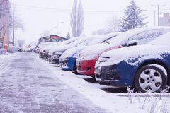 Cars stand in the parking lot near the house in winter. Koscian.Poznan. 21,01,2018 royalty free stock photography