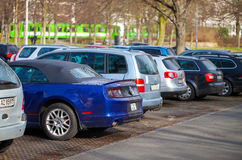 Cars stands on a parking area Royalty Free Stock Images