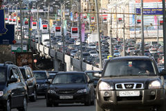 Cars stands in traffic jam on the city center Royalty Free Stock Images