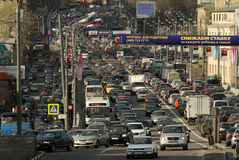 Cars stands in traffic jam on the city center Stock Photos