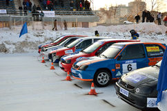Cars at the start of competition on the ice track Stock Images