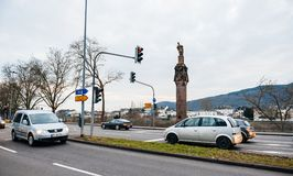 Cars and statue of Emperor Constantine holding a crown. TRIER, GERMANY - FEB 21, 2015: German cars and statue of Emperor Constantine holding a crown with a cross Royalty Free Stock Photos