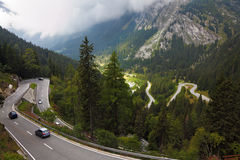 Cars on a steep mountain road turn Stock Image