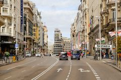 Cars stop at a traffic light in a street in Gran via. royalty free stock photo