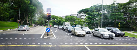 Cars stopping on street in Geyland, Singapore Stock Photo