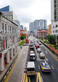 Cars on street in Singapore Stock Photos