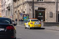 Cars on the street of St. Petersburg on a sunny day. St. Petersburg, Russia - May 04, 2019: Duty car of a private security company in a city street stock images