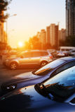 Cars in street. At sunset Royalty Free Stock Photo