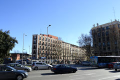 Cars in the street, typical Madrid building in background Stock Images