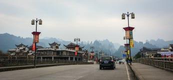 Cars on street in Zhangjiajie town, Hunan, China Royalty Free Stock Images