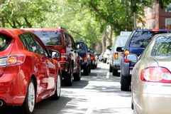 Cars Stuck in Traffic in City Street. Cars stuck in traffic in heavy city street Royalty Free Stock Images
