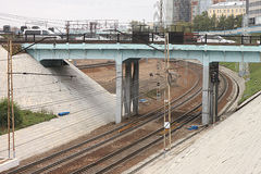 Cars are stuck in traffic on a road bridge over the railway with contact electrical supply network in Novosibirsk in Russia Stock Image