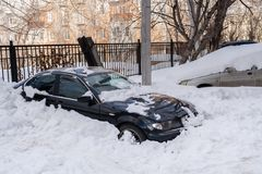 Cars stucked in deep snow in the courtyard of house. Cars stucked in deep snow in the courtyard of house in winter Royalty Free Stock Image
